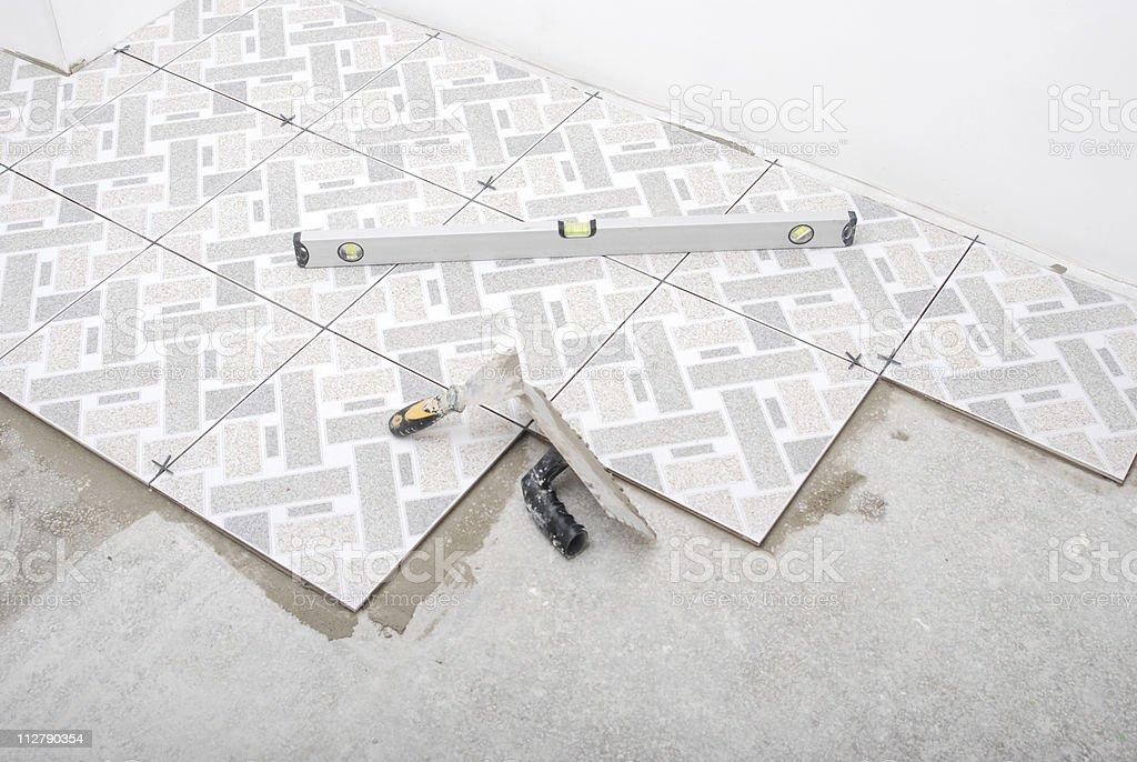 Floor tiles installation stock photo