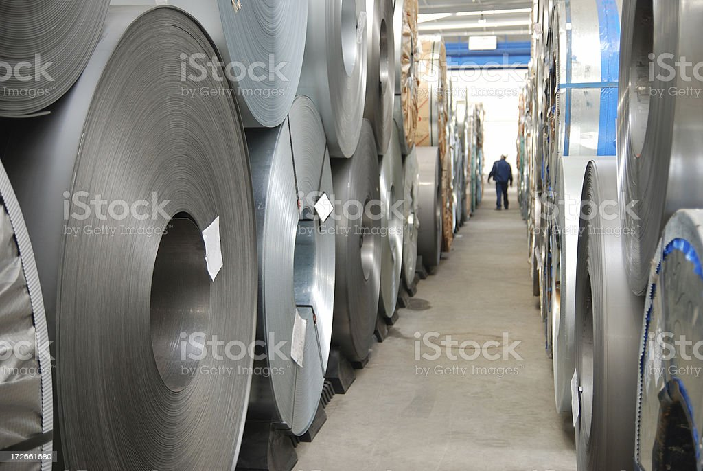 Floor with rolls of sheet steel stock photo