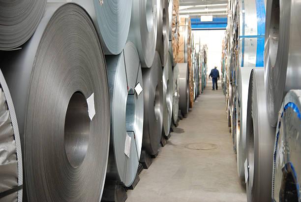 Floor with rolls of sheet steel stock photo