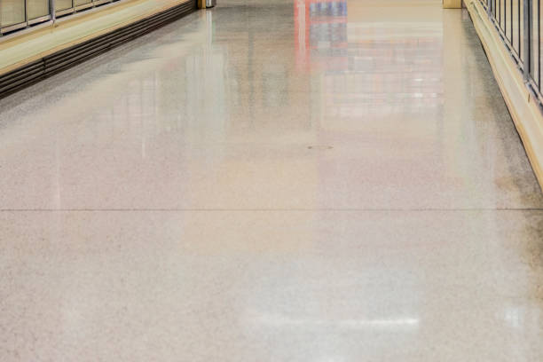 Flooring in an empty aisle of a supermarket frozen food section. stock photo