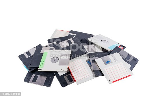Old computer diskettes in a heap isolated on white background