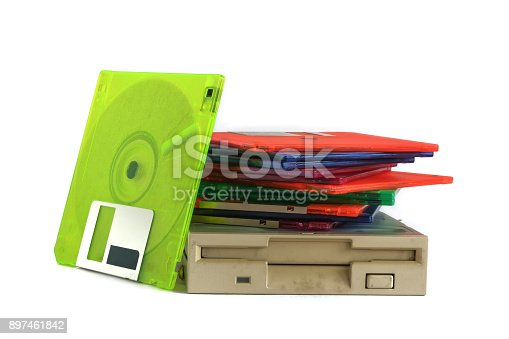 istock Floppy disk drive and diskettes on white background 897461842