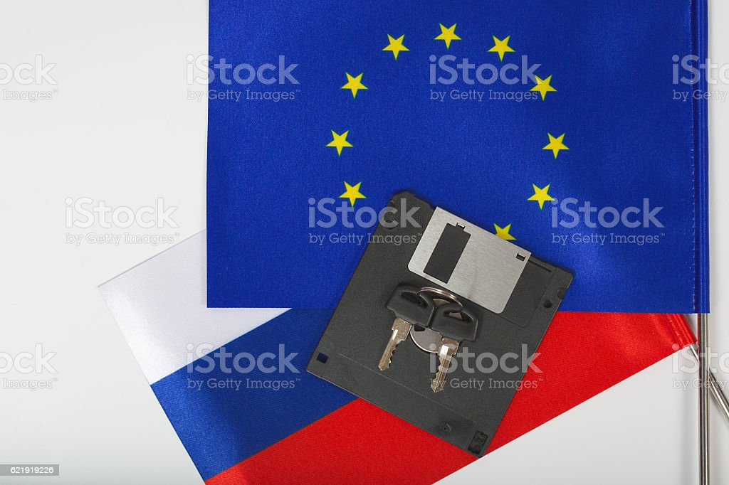 Floppy disk,keys,two flags on a white surface stock photo