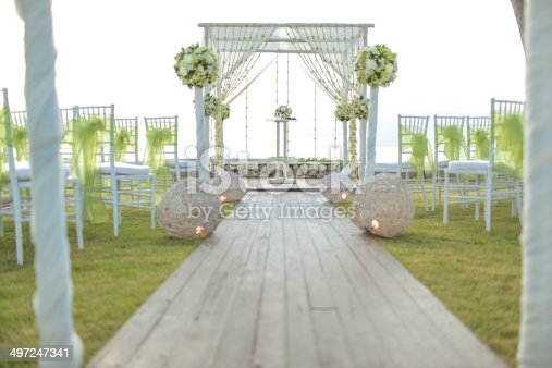 Wedding setting on the garden.Floral arrangement at a wedding ceremony