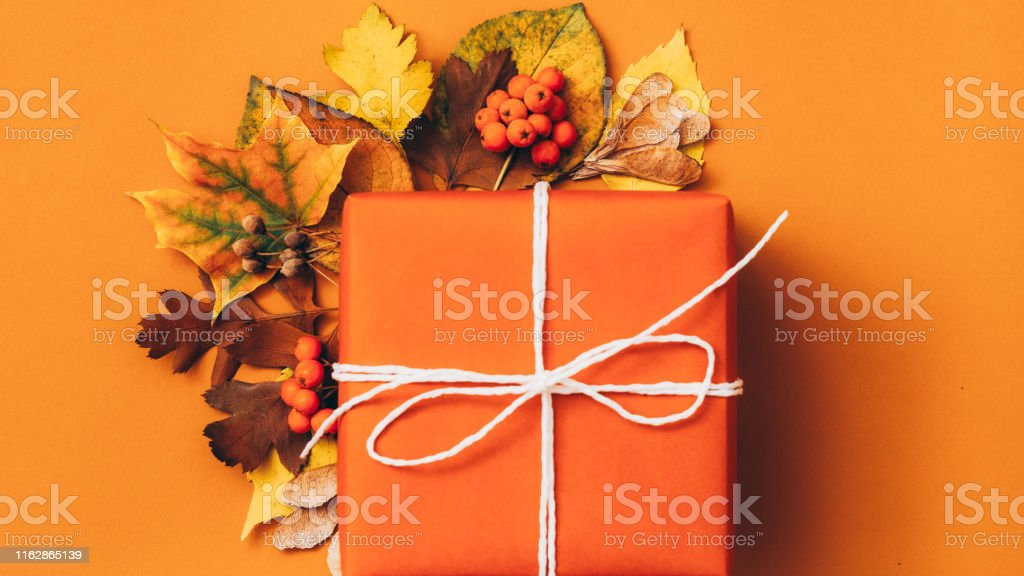 Autumn floral art and craft. Top view of handmade paper gift box with...