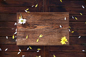 istock floral backdrop on rustic wooden table 1209709667