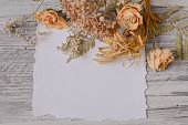 istock Floral background with fern leaves, dried roses and hydrangea 615832796