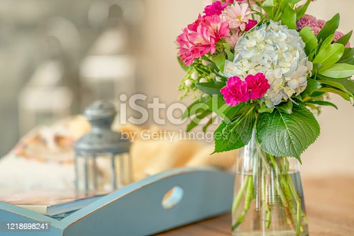 Floral bouquet arrangement set in a country house