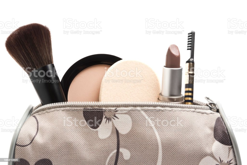 Floral canvas bag with assorted makeup sticking out the top stock photo