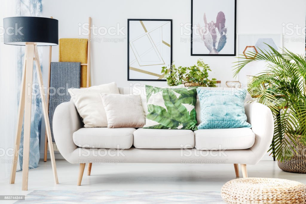 Floral cushion on beige sofa stock photo