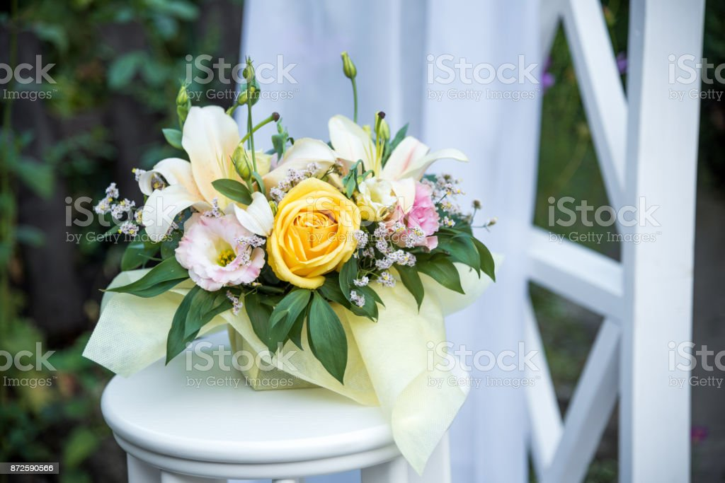 Floral decoration for a outdoor wedding ceremony stock photo