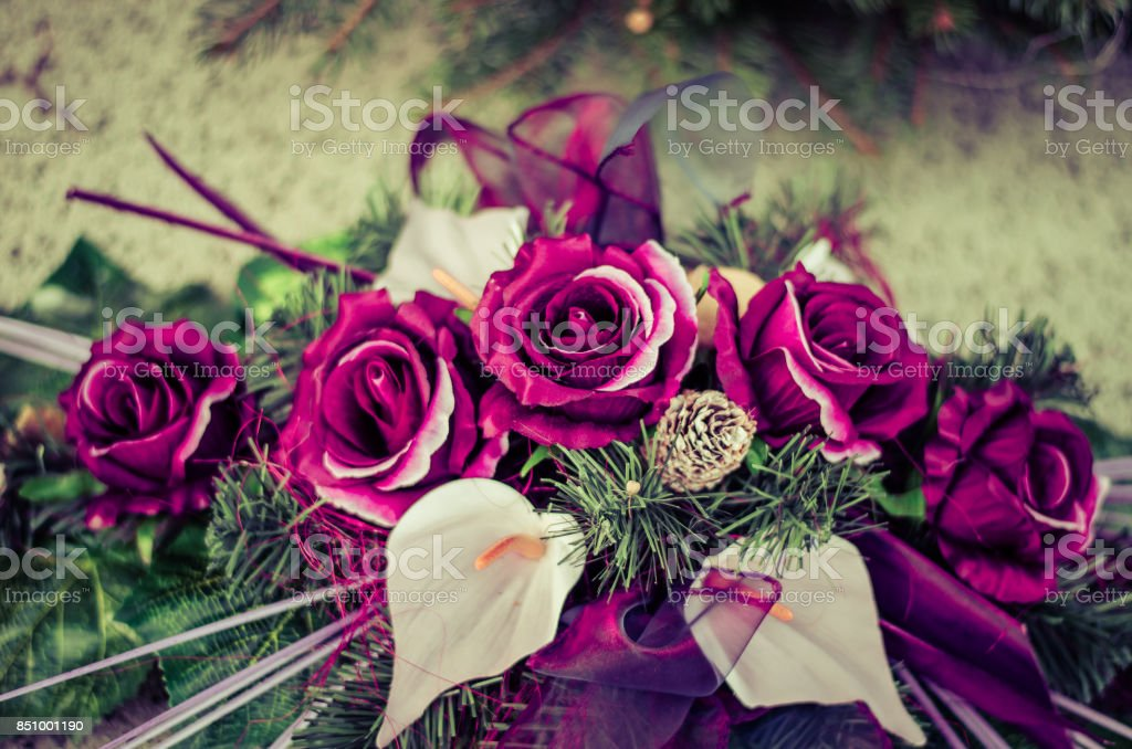 floral decoration on tomb i cemetery during All saints day stock photo