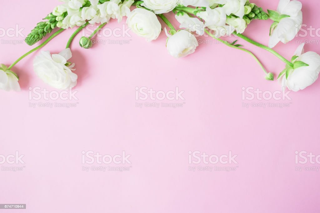 Floral frame of beautiful white flowers on pink background. Flat lay,...