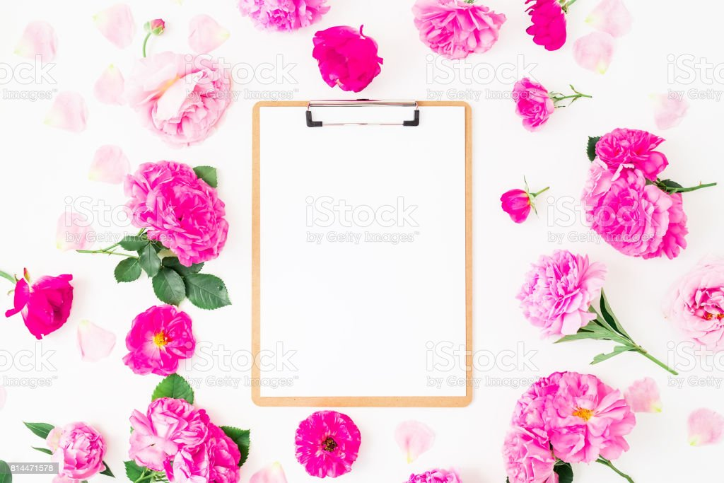Floral frame of pink flowers and clipboard on white background. Flat...
