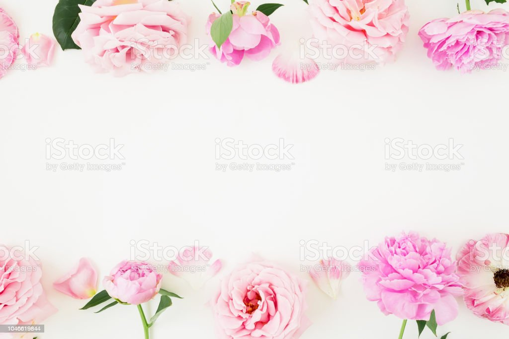 Floral Frame Of Pink Pastel Flowers On White Background Flat Lay Top