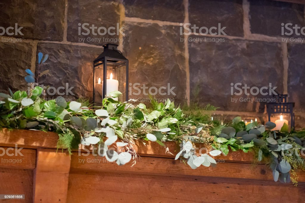 Floral garland of flowers on a fireplace mantle at a wedding venue...