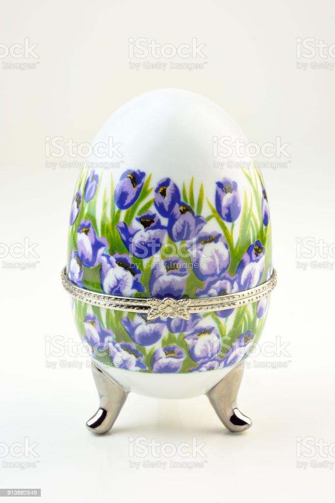 Floral painted decorative porcelain egg stock photo