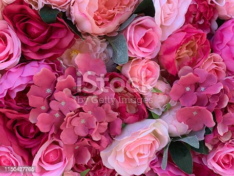 Background of textile roses and hydrangeas in different shades of pink and red.  Pink roses signify gratitude, appreciation and admiration.  Red roses convey deep emotions - be it love, longing or desire and can also be used to convey respect, admiration or devotion.  Pink hydrangeas symbolize heartfelt emotion.