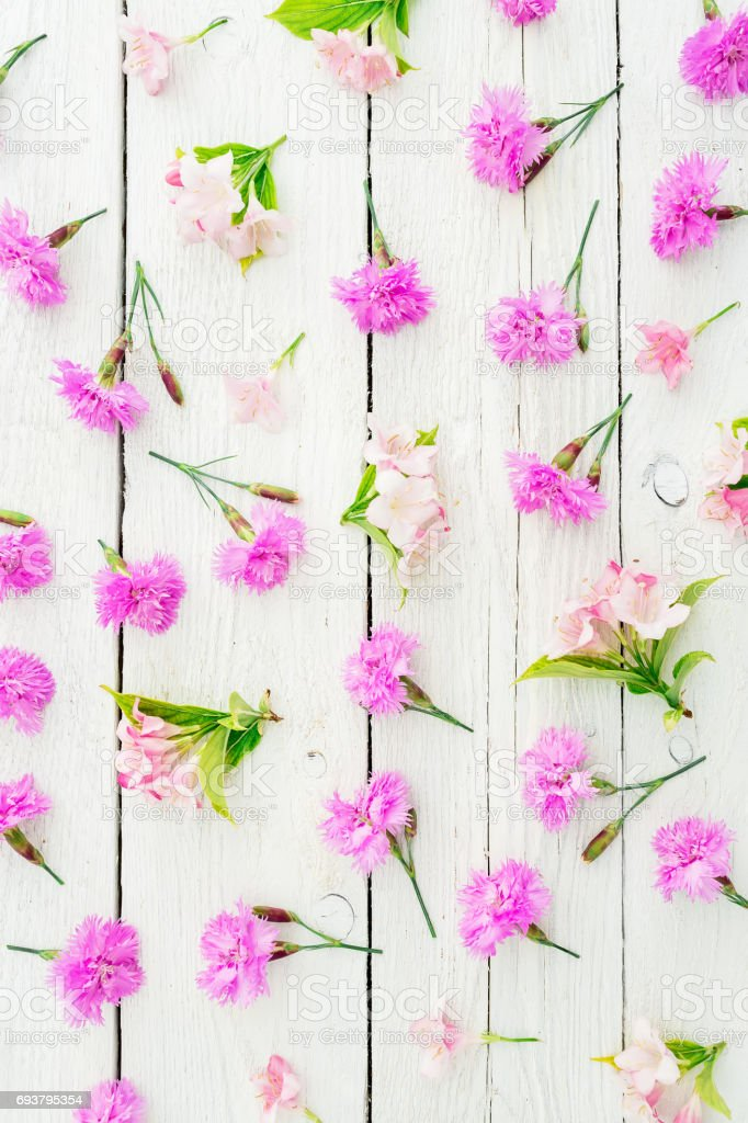 Floral Pattern Made Of Pink Flowers And Leaves On White