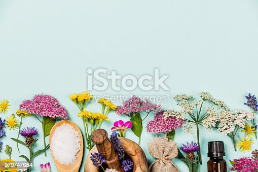 istock Floral pattern made of wild healing flowers and SPA products 979747084