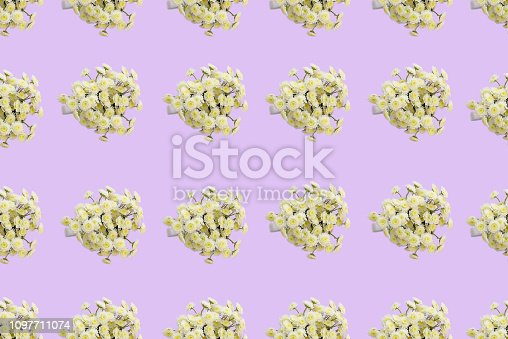 Floral pattern of a series of chrysanthemums on a pink background. Top view flat lay