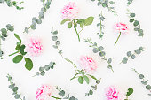istock Floral pattern of pink flowers and eucalyptus branches on white background. Flat lay, top view. Valentine's background 852111684
