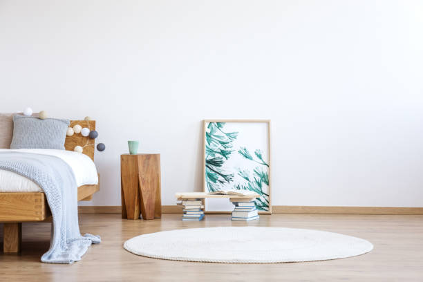 Floral poster in bright bedroom stock photo