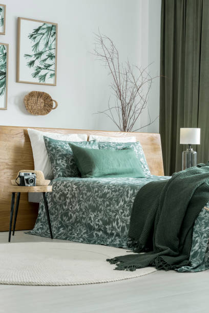 Floral poster in green bedroom stock photo