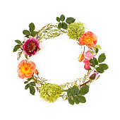 istock Floral round crown (wreath) with flowers and leaves. Flat lay, top view. Mother`s Day concept. 827021498