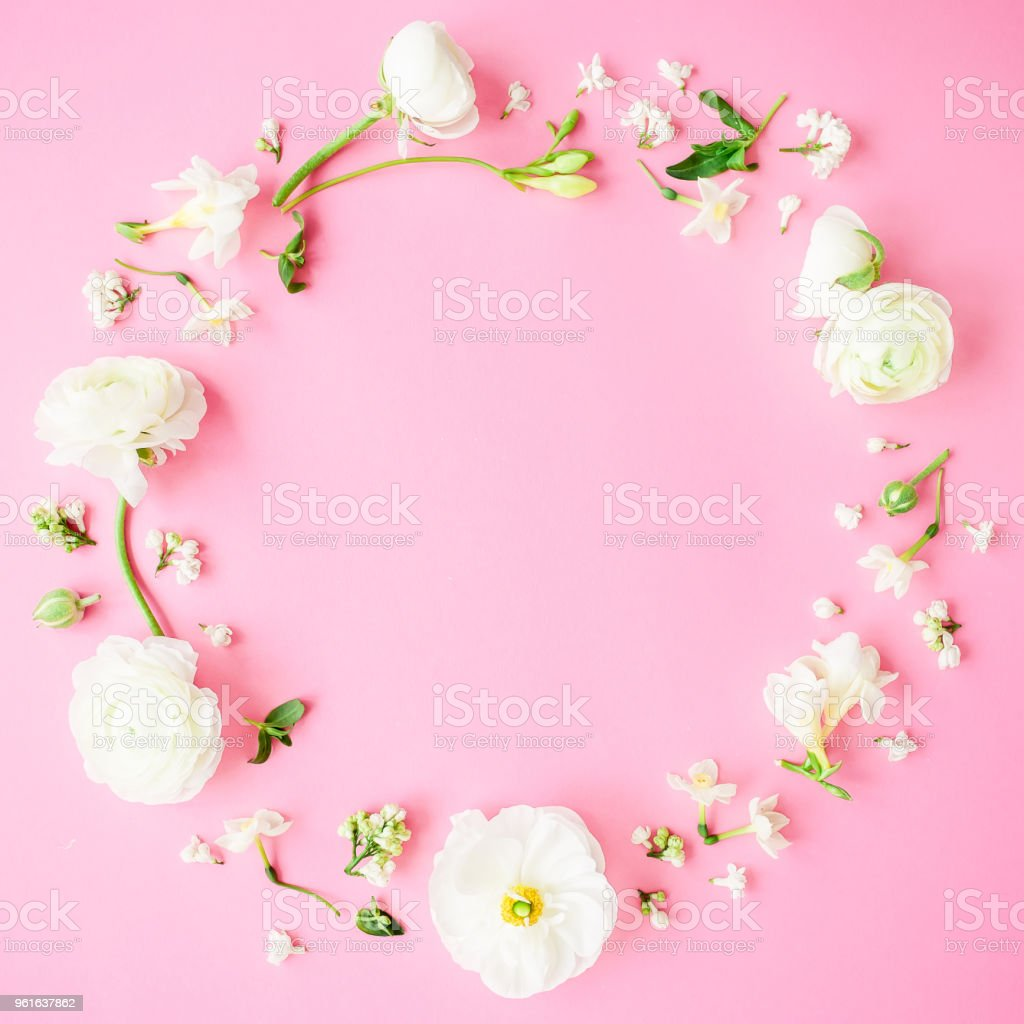 Floral Round Frame Made Of White Flowers Buds And Petals On Pink
