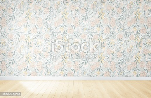 Floral wallpaper in an empty room with wooden floor