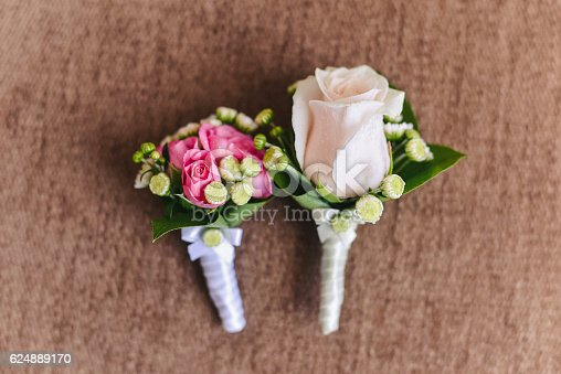 floral wedding boutonniere for the groom of pink roses