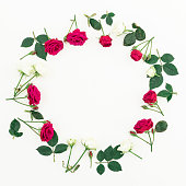 istock Floral wreath frame made of roses isolated on white background. Flat lay, top view. Valentines day background 898798324