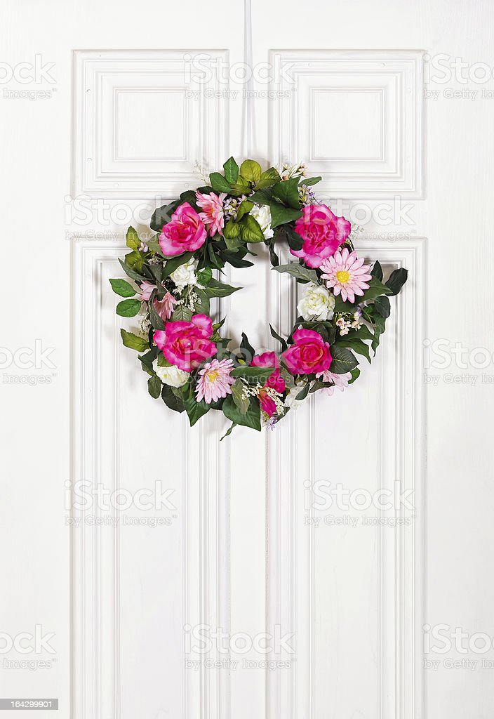 Floral wreath on white door royalty-free stock photo