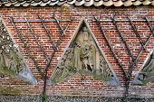 Utrecht, the Netherlands - February 27, 2016: Flora's Hof behind the Dom Tower, in wall made Gothic facade of Saint Marten