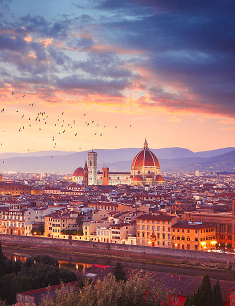 Florence in Italy by sunset Italian town Florence (Firenze) by dusk, Florence Cathedral in the middle, Apennine mountains on the background florence italy stock pictures, royalty-free photos & images