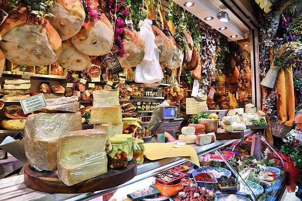 Florence market Florence, Italy - April 30, 2015: Vendor sells cheese at Mercato Centrale market in Florence, Italy. The market is an ultimate Italian shopping experience. It was opened in 1874. florence italy stock pictures, royalty-free photos & images