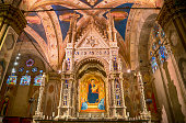 Florence, Italy - February 02, 2017: Interior view of Orsanmichele church in Florence, Italy. The landmark was built in 1337 and is located on Via Calzaiuoli.