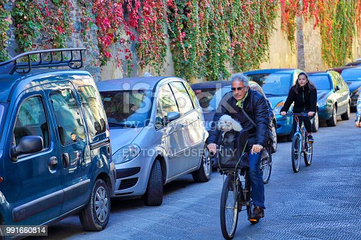 istock Florence residents riding bicycles on the streets in historic center 991660814