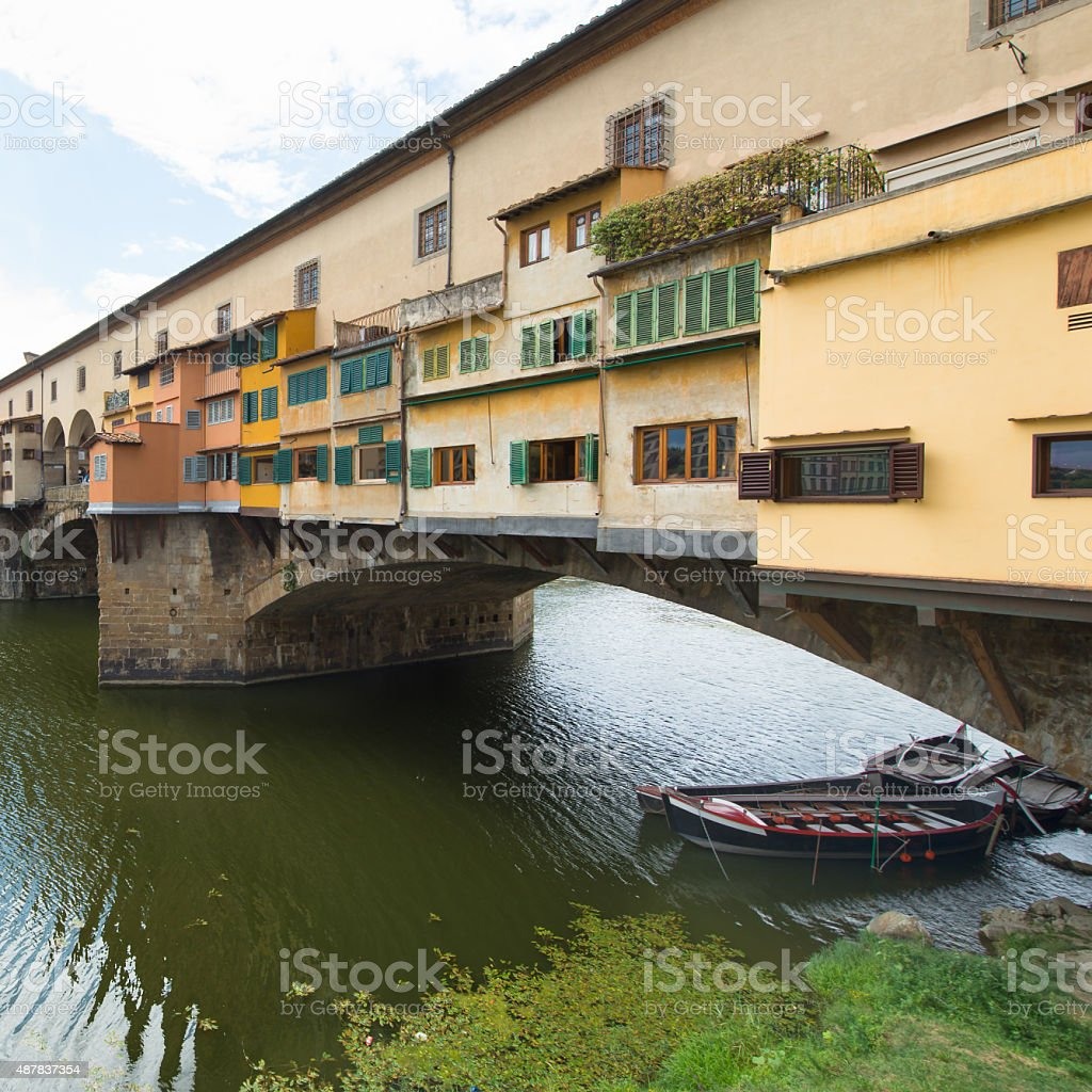 Florence, the old bridge with boats stock photo