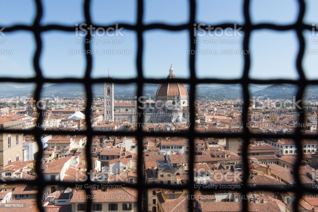Florentine cityscape with the Florence Cathedral. View from over an iron grid of Palazzo Vecchio window, Florence, Tuscany, Italy. - Royalty-free Architectural Dome Stock Photo