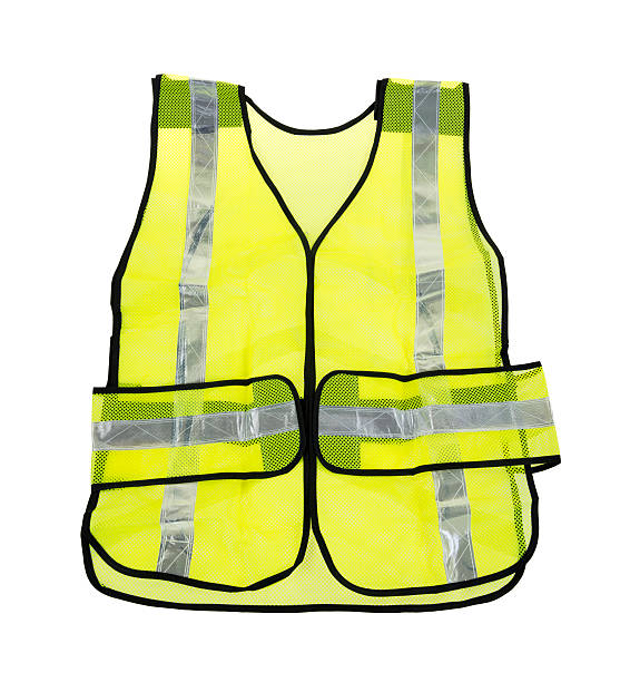 Florescent yellow safety vest A large florescent yellow safety vest with several reflective silver stripes on a white background. reflective clothing stock pictures, royalty-free photos & images