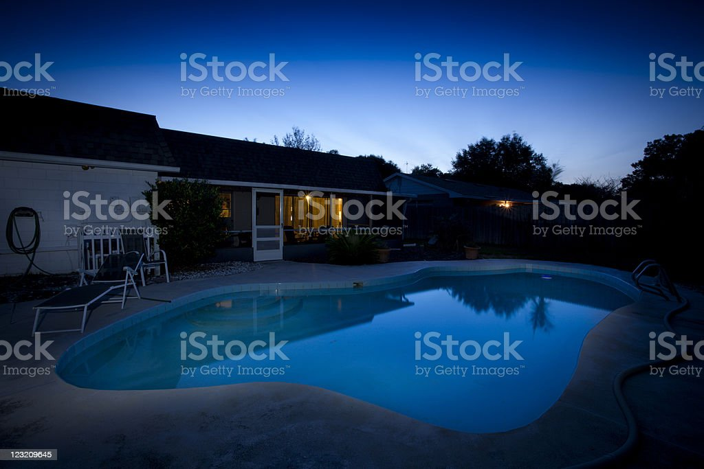 Florida backyard and pool at dusk stock photo