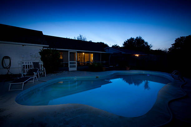 Florida backyard and pool at dusk stock photo