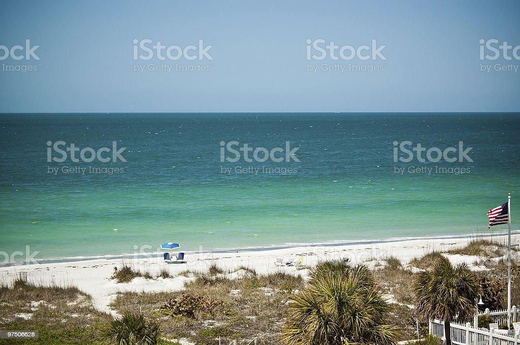 Florida Beach Scene with American Flag royalty-free stock photo