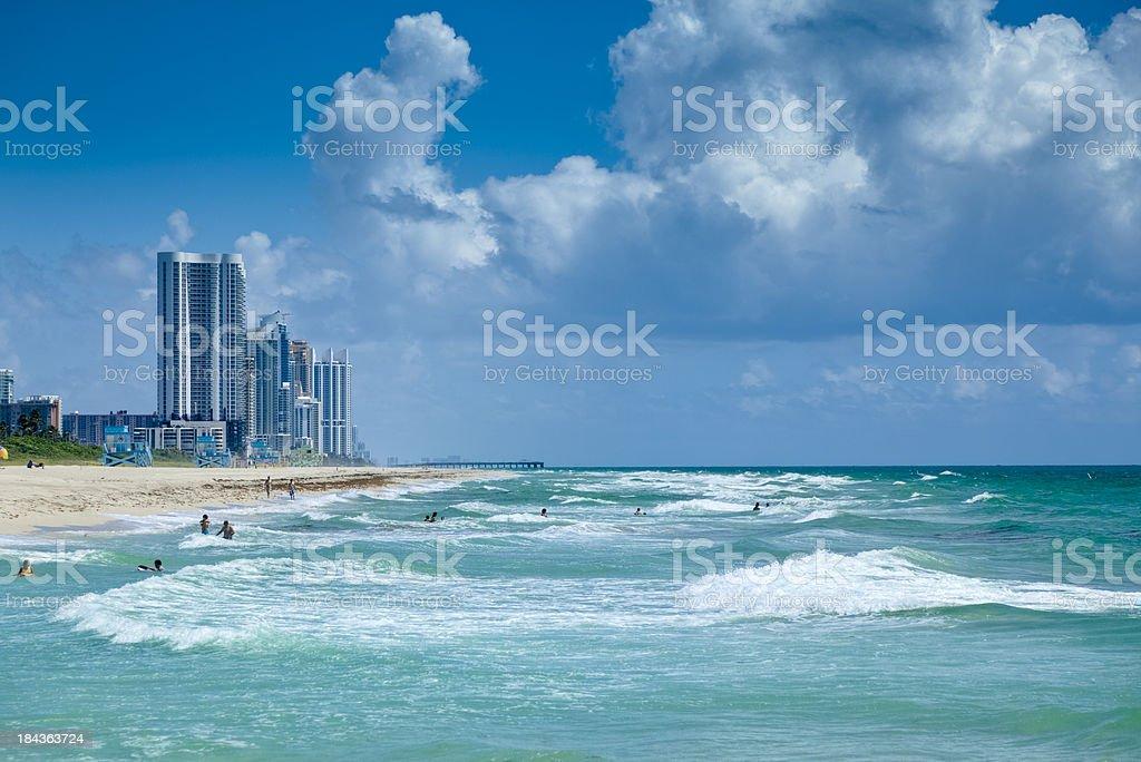 Florida Beach With People Enjoying the Surf stock photo