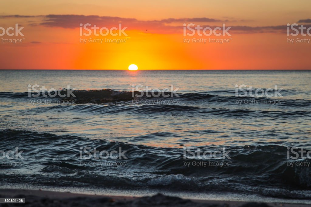 Florida beach with waves and sunset stock photo