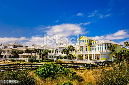 Large homes with wide multi level porches look over the Atlantic ocean beaches in Saint Augustine Beach, Florida