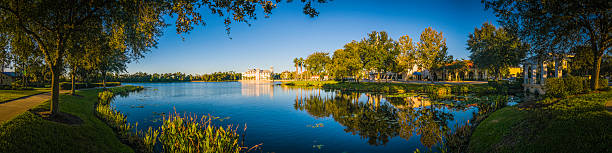 florida blue lakeside living tranquil summer suburban homes sunrise usa - kissimmee stock photos and pictures