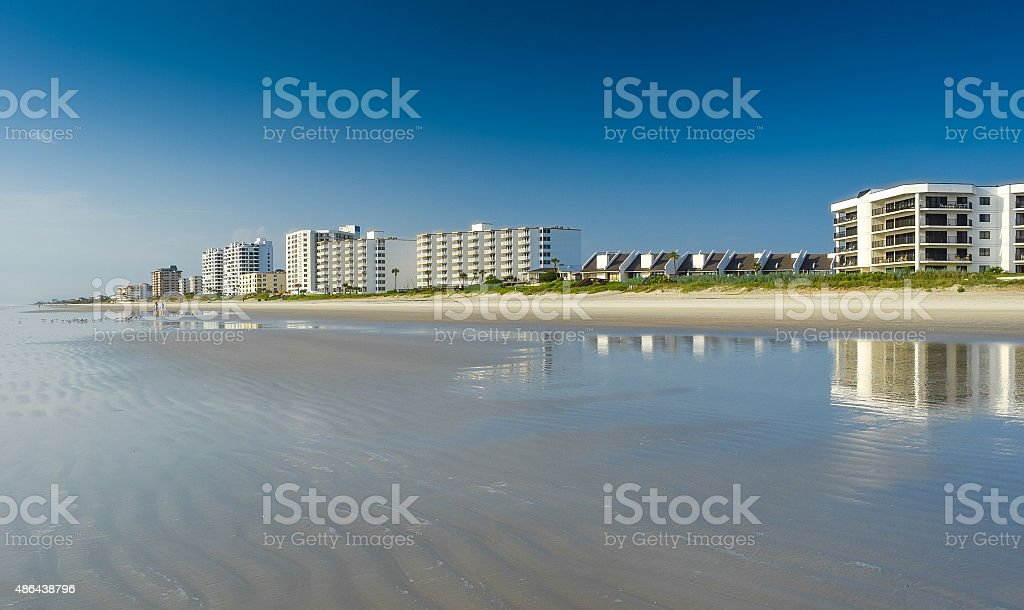 Florida Condos Reflected on Sandy Beach at Dawn stock photo